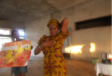 Another participant Mrs. Dandy Ndife demonstrating breast self examination (BSE) to others