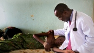 Dr-Henry-Ddungu-Treating-Cancer-Patient_Kampala-Uganda_flipped_1200px_0.jpg