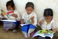 Lao_schoolgirls_reading_books.jpg