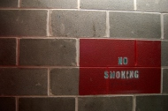 No_Smoking_greybrickwall_1024px.jpg
