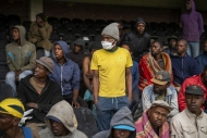 Homeless people stay at the Caledonian stadium downtown Pretoria, South Africa, April 2, 2020, after being rounded up by police in an effort to enforce a 21-day lockdown to control the spread of the coronavirus.