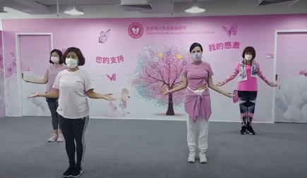 asian women doing a virtual fitness exercise session for breast cancer awareness month.