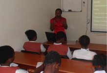 Miss Uzoma Ijeoma explaining what Breast Without Spot Initiative is all about to the students from U.N.S.S.E.C.