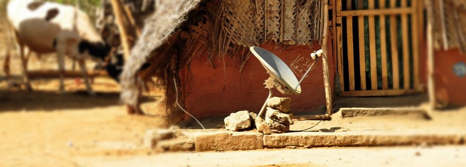 1280px-Satellite_dish_in_hut.jpeg