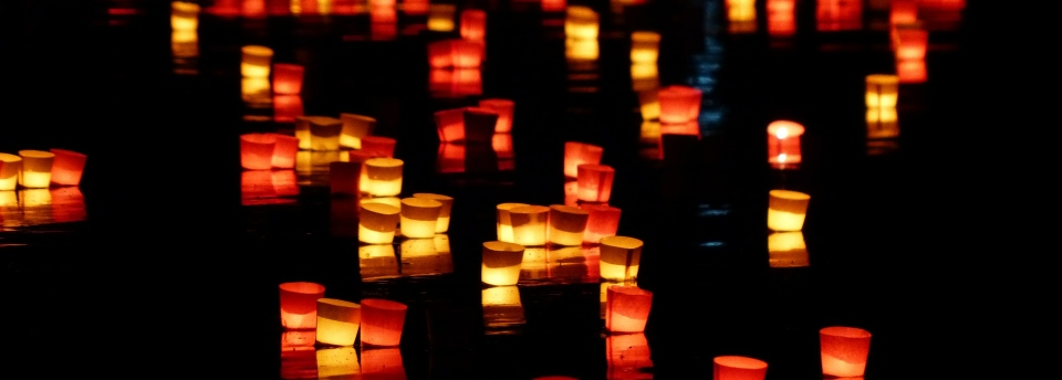 Candles on the water by night