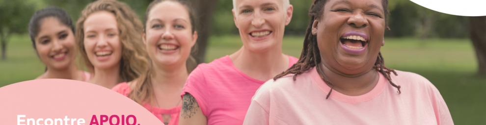 Women smiling dressed in pink for Breast Cancer Awareness Month