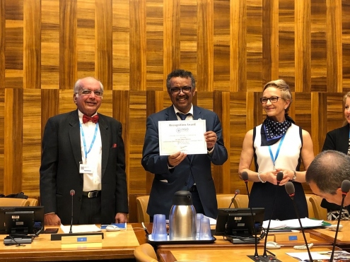 WHO DG Dr Tedros receiving a recognition award recognising the momentum that his leadership brings to the goal to eliminate cervical cancer globally