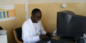 Smiling_african_doctor_Comp_full_clean_1200px.jpg