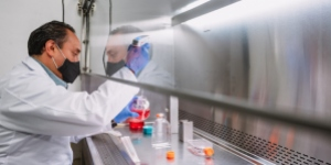 Man in white coat in a research lab