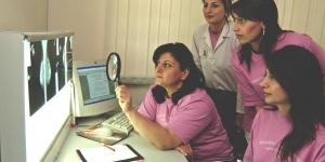 Hospital staff examining an x-ray