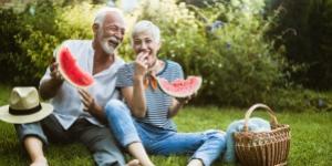 Elderly couple eating watermelon symbolising a healthier lifestyle through nutrition