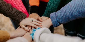 National efforts to improve equity in access to cancer treatment and care - Photo by Hannah Busing on Unsplash - Hands