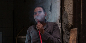 Middle Eastern man smoking a hookah